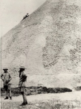 Percy Coriat climbing Ngundeng's Mound, January 1928 (Coriat's photos, Pitt-Rivers Museum)